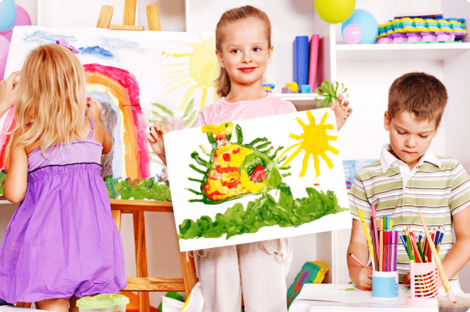 child showing her painting